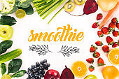 top view of arrangement with fresh vegetables, fruits and berries isolated on white with 'smoothie' lettering