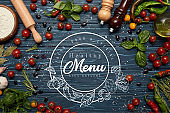 fresh raw vegetables, spices and rolling pin on wooden background with 'healthy menu' lettering