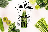flat lay with detox drink and various organic food isolated on white with 'drink smoothie and enjoy life' inspiration