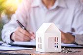 Man working saving money to buy new house