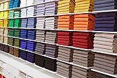 Colorful shirts inside fashion store shelves