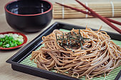 Soba noodles with dried seaweed on plate, Japanese food