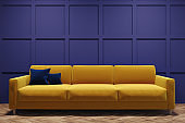 Yellow sofa in a purple room