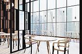 Loft restaurant interior, round tables