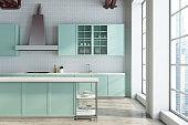 White kitchen, green countertops close up