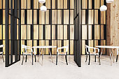 Stylish restaurant interior, wooden walls