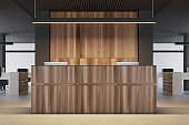 Wood and black office reception close up