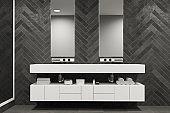 White sink vanity unit in a black bathroom, double