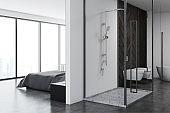 White bedroom and bathroom interior
