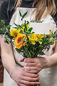Florist holding bouquet beautiful flowers