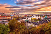 Sunset in Prague, view to the historical bridges, old town and Vltava river from popular view point in the Letna park, Czech Republic
