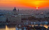 Budapest, Hungary - Beautiful golden sunrise over Budapest with St. Stephen's Basilca, cruise ship on River Danube