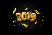 Happy New 2019 Year background. Golden metallic numbers 2019 and shining confetti particles and ribbons. Vector 3d gold numbers. Holiday poster or banner design