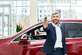 Happy Mature Man Presenting Car Keys