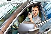 Happy Man Inside New Car