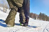 Snowboarder Putting On Gear