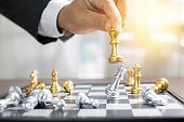 success, management and business leadership concept,hand of  businessman moving king chess to win by using strategy and planning