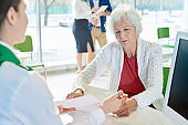 Concentrated senior customer reading confirmation contract