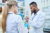 Two Young Scientists in Laboratory