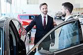 Businessman Buying New Car