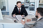 Salesman with contract of rent a car