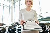 Cheerful Saleswoman with Contract
