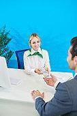Smiling bank representative giving loan to businessman