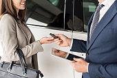Car Salesman Giving Keys to Client