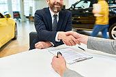 Business Deal in Car Showroom