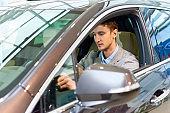 Handsome Man Inside New Car