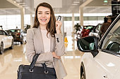 Beautiful Woman Holding Car Keys in Showroom