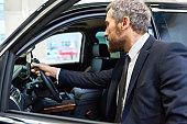 Mature Man Choosing Car for Rent