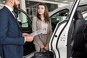 Beautiful Woman Choosing New Car