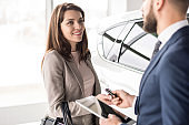Car Salesman Working with Client