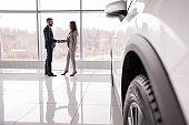 Car Salesman Shaking Hands with Customer
