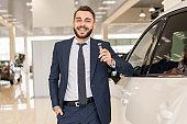 Handsome Car Salesman Holding Keys