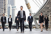 Teamwork and professional partnership concept, businesspeople team of multi ethnic walking  with confidence in full suit