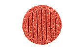 Close up on a raw ground beef burger steak patty isolated on white background.