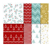 Vector illustration set of seamless bright Christmas patterns with snow and christmas trees in flat cartoon style.
