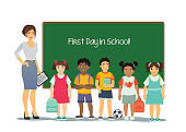 Vector illustration of female teacher with kids of different nationalities at white background with green school board. Children at school in first time in cartoon flat style.
