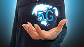 Businesswoman on blurred background using 5G network interface
