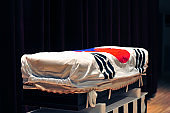 A Korean flag-covered coffin