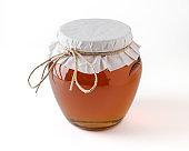 Honey in jar on white background.
