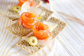 Delicious appetizer canape with salmon and cheese.