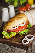 Fresh homemade sandwich with meat and tomatoes
