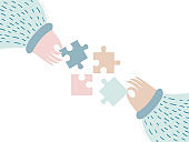 Puzzle vector illustration. Teamwork business concept. Two people connecting puzzle elements.