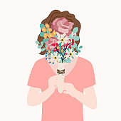 A woman covered with a bouquet. flat vector design illustrations.