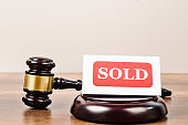 Sold tag with wooden gavel