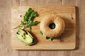 avocado and arugula sandwich on bagel bread