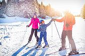Happy family on a ski trip